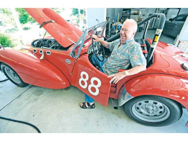 James Degnan, of Castaic, sits in his 1952 Allard K2 race car. Degnan has collected and raced vintage cars since the 1980s.
