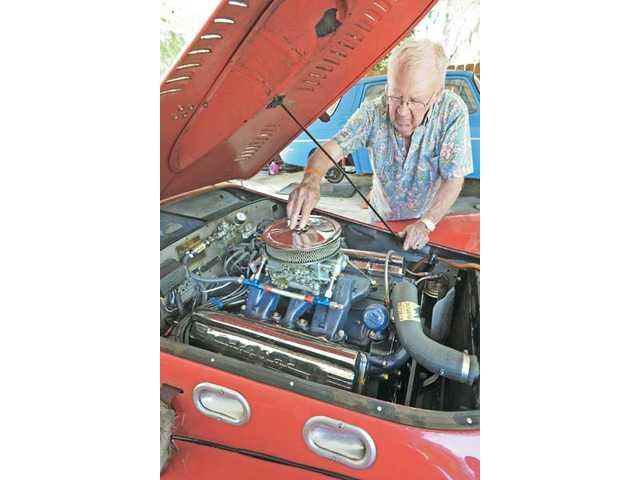 An American-made Cadillac engine sits inside Degnan's 1952 British Allard K2 race car.