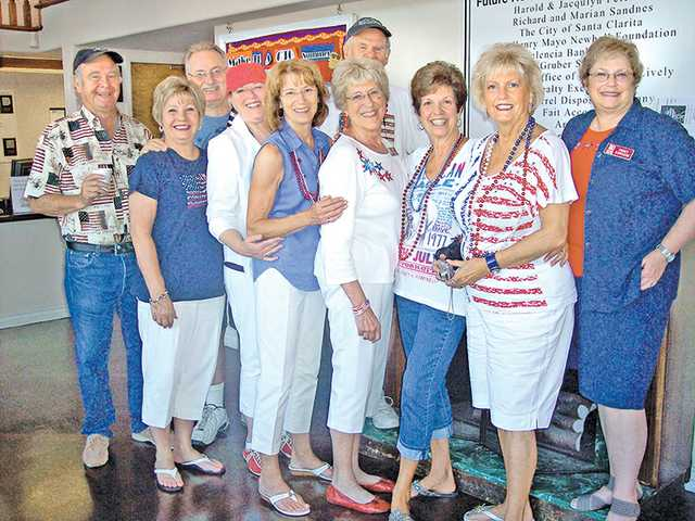The ladies of the Zonta Club of Santa Clarita Valley and their gentlemen helpers serve up the annual Red, White and Blueberry Breakfast. The prime seats  for the parade and the breakfast served by the Zontians are an eagerly sought-after auction item at the annual Zonta Tribute Dinner.