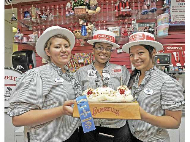 "Lapree Schlender, Janay Jackson and Kimberly Morales show a Pig's Trough at Farrell's Ice Cream Parlour, inside Mountasia Family Fun Center in Saugus. If you finish the Pig's Trough you get a ribbon that reads, ""I made a pig of myself at Farrell's."" You'll also be celebrated with one of Farrell's songs."