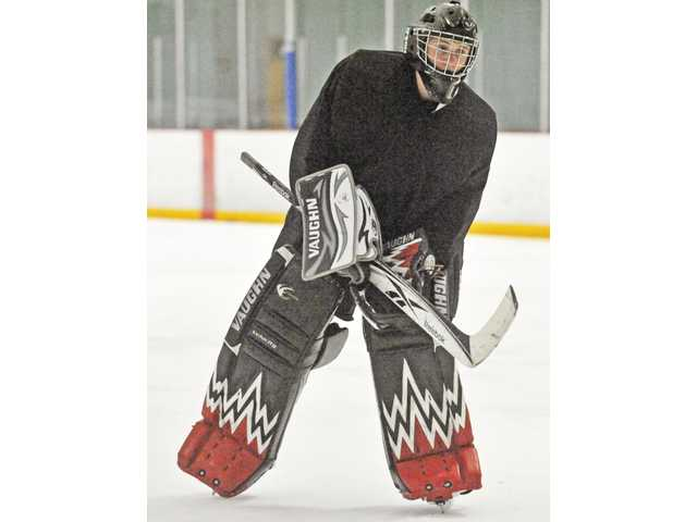 Hart High senior Ben Newberry tries out for goalie at the Valencia Flyers hockey camp on Friday at Ice Station Valencia.