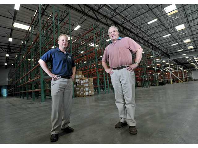 President Jay Catlin, left, and CEO Ken Wiseman of AMS Fulfillment stand in the company's newest 120,000-square-foot warehouse in Valencia. The company recently opened a sixth warehouse, and is now looking for a seventh site.