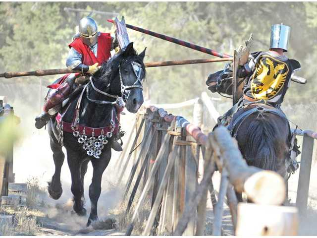 "James Zoppe, left, ""The Red Knight"" on his horse Iron, makes contact with Marcus Coleman, ""Sir Marcus of Valencia,"" on his horse Guenevere during a jousting contest of The American Jousting Alliance at Zoppeland on Sunday."