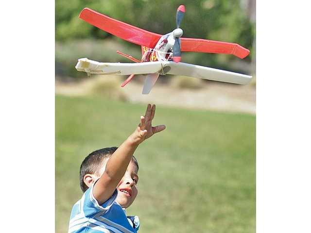 Diego Campollo, 5, of Canyon Country, releases his air-powered Air Hogs model airplane at Valencia Heritage Park in Valencia on Tuesday.