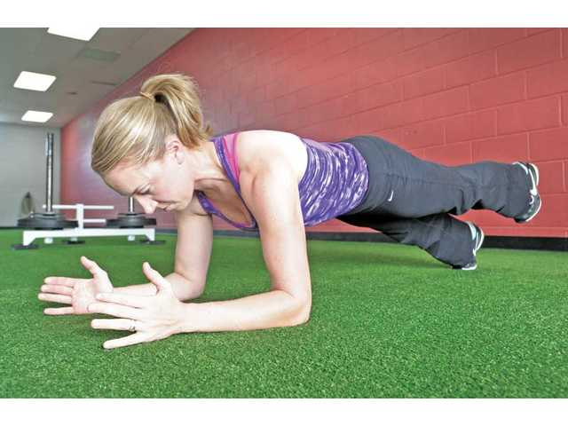 Plank with leg extension.