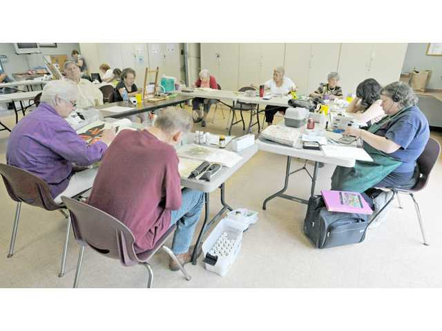 Students work on art projects during an art class at the Santa Clarita Valley Senior Center on Thursday.