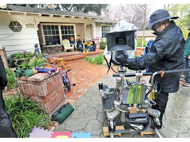 "Michael Alvarez sets up a camera for the show ""Justified"" at a home in Newhall on Feb. 25."
