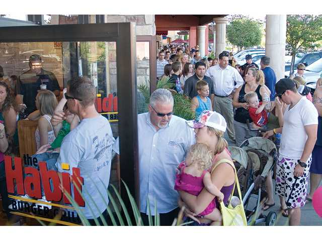 Hundreds stand in line outside the Habit Burger Grill in Valencia on Monday. They came for a fundraiser to cover the funeral costs of Macy, a 5-year-old Santa Clarita girl who died July 7 in a car crash.