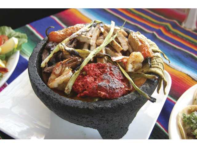 A unique Azul Tequila dish sure to please carnivores everywhere is the molcajete ($13.99), a decadent mix of beef, chicken, pork and chorizo, topped with shrimp and draped with grilled cactus.