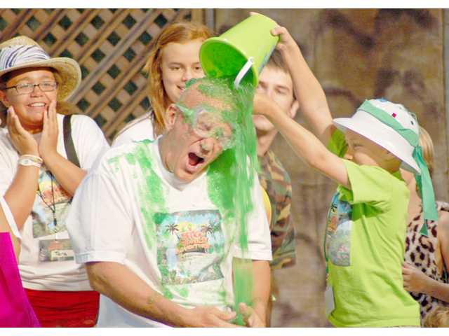 Pastor John Koczman has green Jell-O poured on him during Bethlehem Lutheran Ministries' vacation Bible school last week as part of a fundraiser for ZOE International.