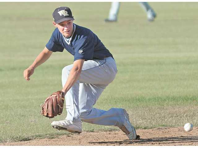 West Ranch's J.D. Krauskopf makes a backhanded stab on a ground ball on Friday at West Ranch High in the second round of the VIBL playoffs.