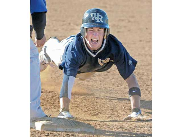 West Ranch's Jagger Rusconi dives back into first base to beat a throw after getting a hit in the sixth inning on Friday at West Ranch High in the VIBL playoffs.