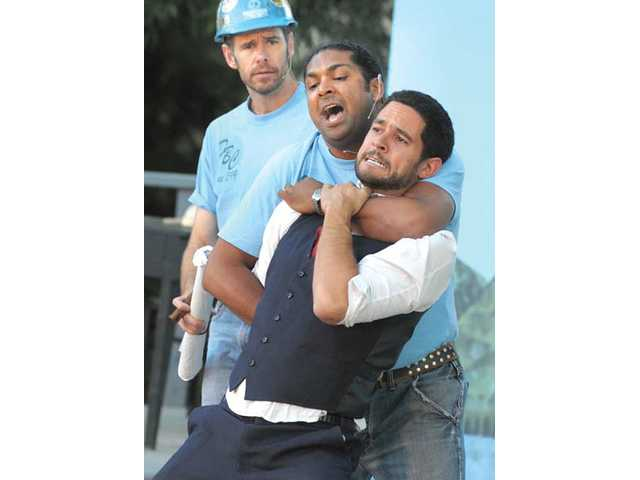 "Brothers Orlando (Gugun Deep Singh, center, and Oliver (Fernando Belo, right, fight over their inheritances as Adam (Tom Burton) looks on as the group performs an adaptation of Shakespeare's ""As You Like It"" at the Santa Clarita Shakespeare Festival held at Towsley Canyon Park in Santa Clarita on Saturday."