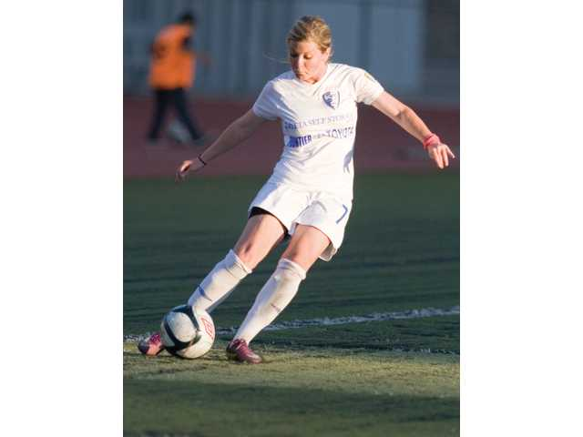 Santa Clarita Blue Heat midfielder Stacey Rodwell takes a free kick during the first half against the Vancouver Whitecaps on Sunday night at College of the Canyons. Santa Clarita lost the game 4-3, marking an end to its season.