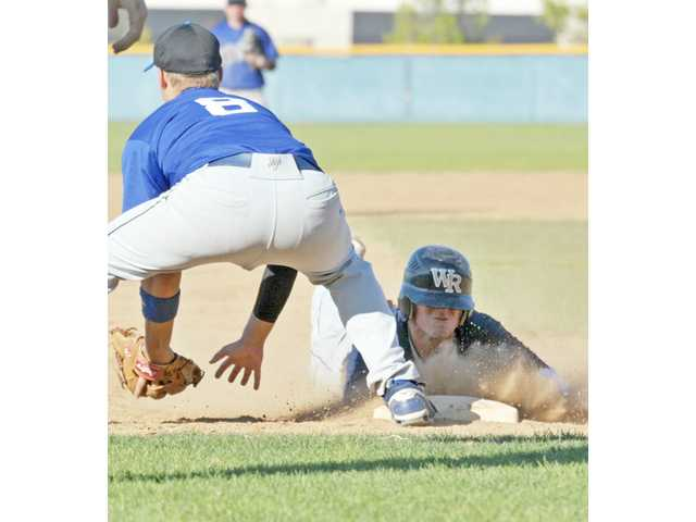 West Ranch catcher Josh Heinz, right, slides safely into third base after hitting a triple in the second inning against Woodland Hills West on Monday at West Ranch in the quarterfinals of the Valley Invitational Baseball League playoffs.