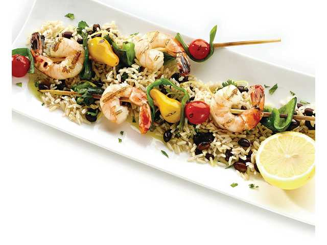 Skewered shrimp with black bean-lemon rice