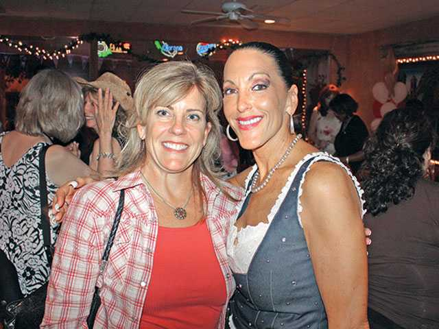 Left to right, Valerie Chase, a new member of SIGSCV and Shelley Hann, installation co-chairwoman. Among the signature fundraisers of the philanthropic group is the annual Wine Affair to benefit breast cancer and the High Heel-a-thon to benefit domestic violence.