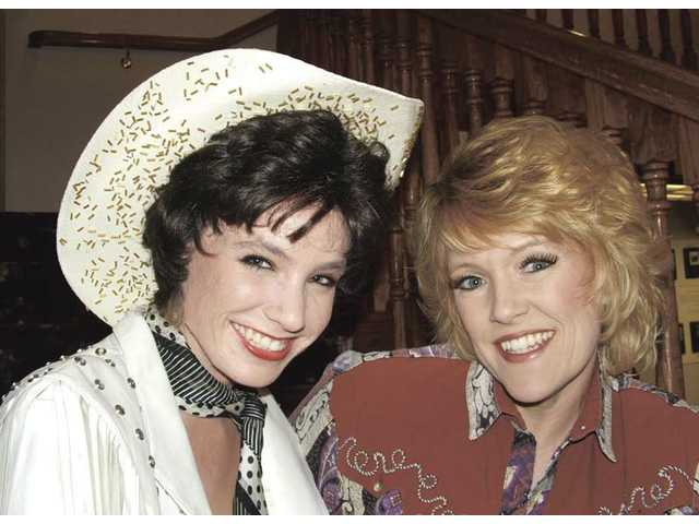 "Marie Wise-Hawkins, as Patsy Cline, left, and Dawnita Kay Shelden, as Louise Seger, in ""Always ... Patsy Cline."""