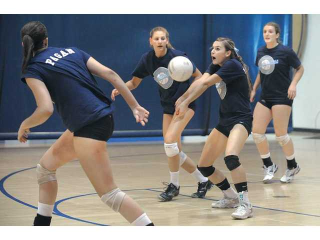 Saugus volleyball players from left, Ashley Pagan, Sarah Blomgren, Kristin McCord and Makenna Wasserman compete in a scrimmage against Notre Dame on Wednesday at Saugus High, one of the sites of this weekend's varsity tournament which will involve five Foothill League teams.