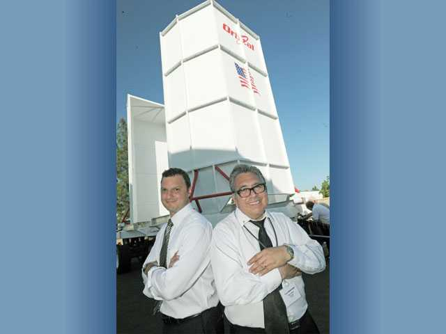 Dave Cochran, left, and Rick Montoya, pose in front of their Cygnus Vertical Container at Vivace-Spacetron's office in Valencia on Thursday.  The Vivace-Spacetron transporter will safely ferry the Cygnus spacecraft around Orbital Sciences' 20-mile launch pad in Virginia.