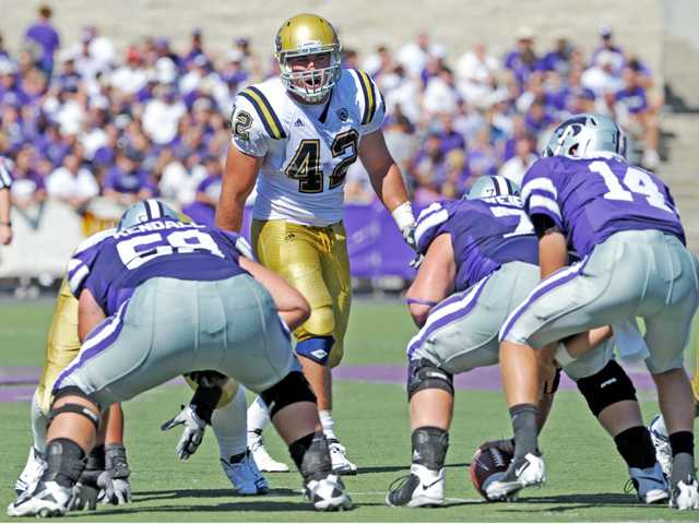 Hart High graduate and UCLA linebacker Patrick Larimore (42) awaits a snap in a game against Kansas State last season. Larimore has the ability to channel his anger and aggression into his play, which is an important part of being a successful athlete.