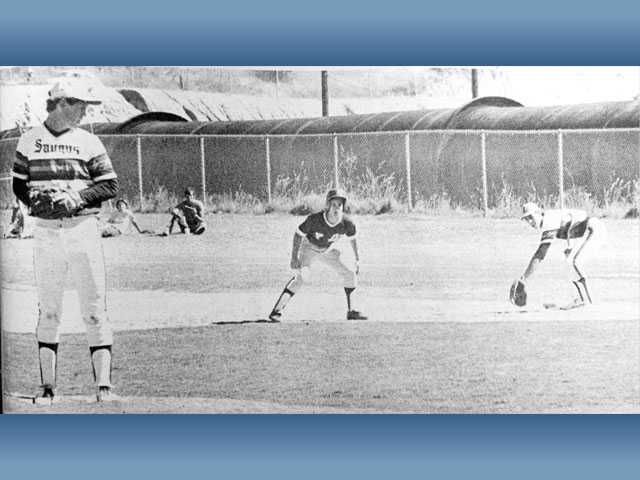 "Saugus High pitcher Steve French, left, eyes a La Canada baserunner during a game in May of 1978. Under head coach Doug Worley, Saugus employed the ""Centurion Defense,"" an elaborate play designed to trick the runner into thinking the pitcher had overthrown a pickoff attempt."