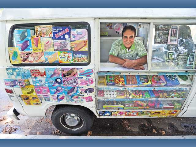 Ice cream vendor Paramjit Cheema, of Valencia, parks his truck at Valencia Glen Park in Valencia on Saturday. Cheema has driven his truck for more than 11 years.