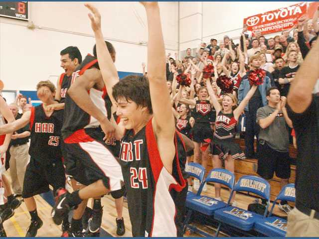 Hart's Josh Herman (24) and the rest of the boys basketball team celebrates a win in the 2005 CIF-Southern Section Division IAA semifinals.