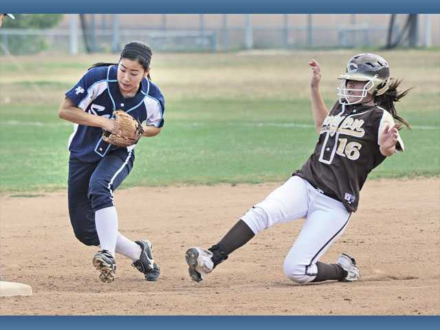 Saugus' Emi Shimamoto, left, tries to beat Canyon of Anaheim's Jessica Munoz to second on May 19 at Saugus High. Despite ending Valencia's 10-year Foothill League reign, the Centurions were upset in the first round of the playoffs.