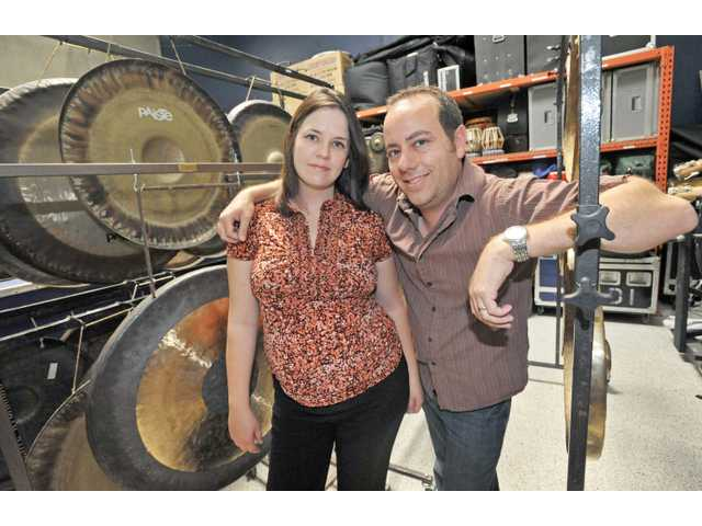 Owners Abby and Dan Savell stand in their warehouse at L.A. Percussion Rentals in Santa Clarita.