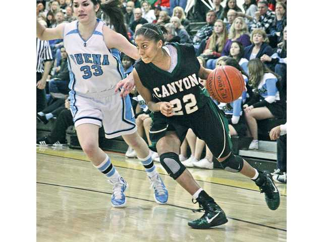 Former Canyon guard Shorty Dent (22) drives to the basket against Buena of Ventura on Feb. 26 in the semifinals of the CIF-Southern Section Division IIAA playoffs. Canyon lost 60-53.