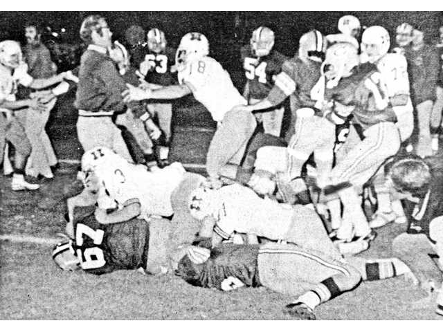Members of the Hart and Canyon football teams fight during their game in 1974. The rivalry between the two schools has been key in shaping the athletic landscape of the Santa Clarita Valley.