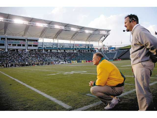 Former Canyon head football coach Harry Welch, left, took a hard-line approach with his players, but the goal was more than winning. It was building character.