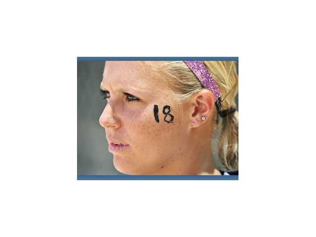 Hart High graduate Jessica Shults wears her No. 18 on her cheek, as did her University of Oklahoma teammates when they played in the NCAA Tournament without her.