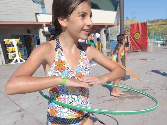 Marissa Scaccia, 10,  participates in the Hula-Hoop competition at the SCV Water Festival to benefit Single Mothers Outreach of  Santa Clarita.