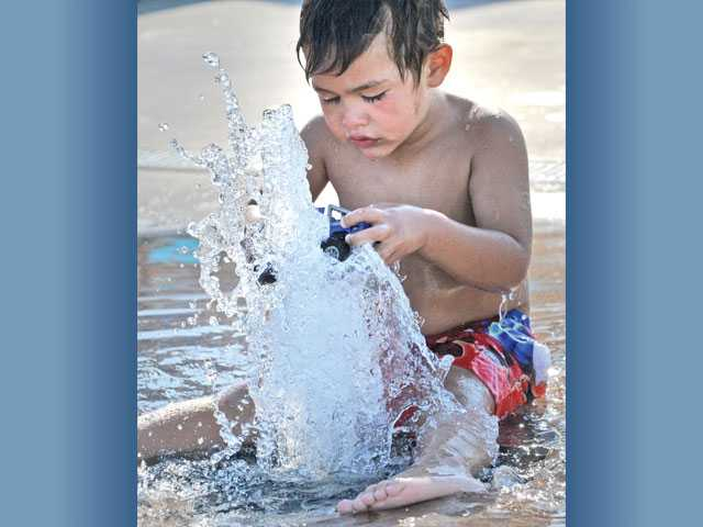 Carlos Nova, 4, of Canyon Country, plays in a water fountain.