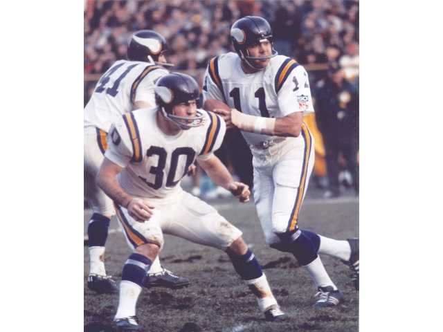Hart High graduate Joe Kapp (11) drops back to pass as the quarterback of the Minnesota Vikings during Super Bowl IV in New Orleans on Jan. 11, 1970. Kapp is the only American athlete to play in the Rose Bowl, Super Bowl, and Canadian Football League's Grey Cup, and at each milestone, he was prepared by the one that preceded it.