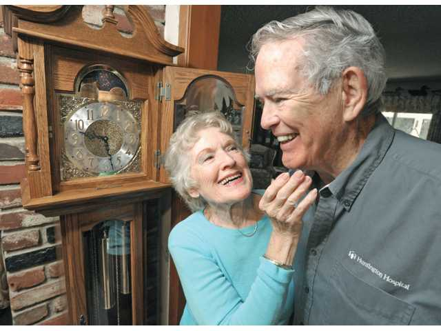 Bobbie, left, and John Stephens and the grandfather clock that brought them together at their home in Newhall on Wednesday.