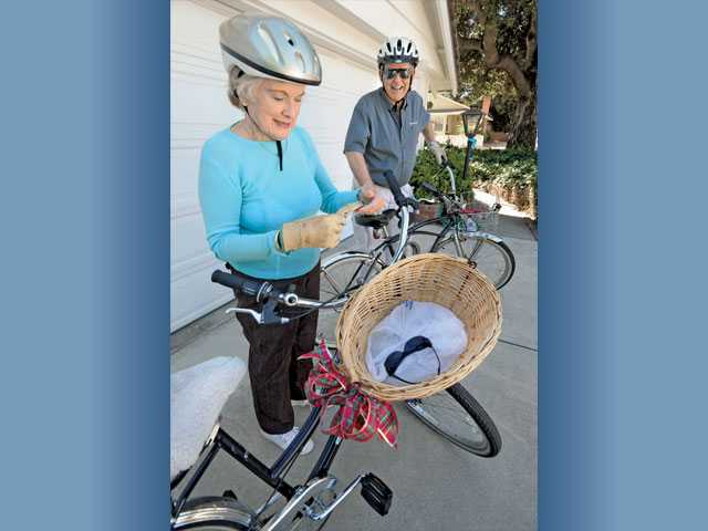 Bobbie, left, and John Stephens prepare for a bike ride at their home in Newhall on Wednesday.
