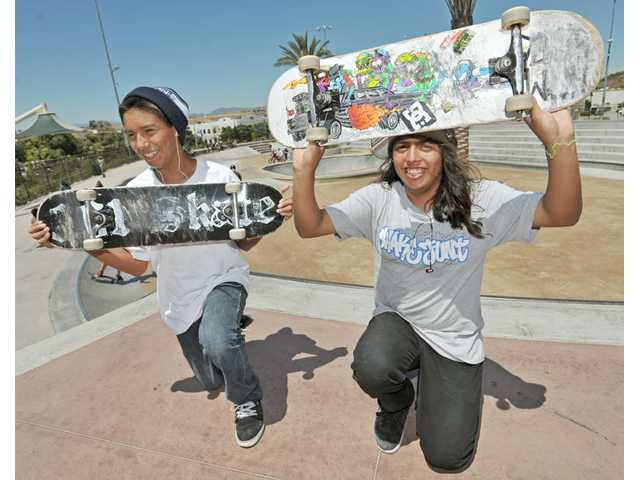 David Martinez and Nas Angulo, both 15, of Santa Clarita, show off their skateboards at Santa Clarita Skatepark in Canyon Country recently.