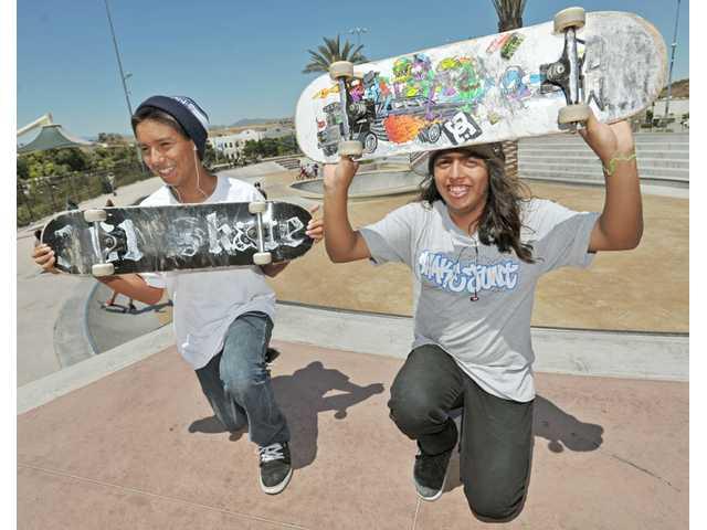 David Martinez and Nas Angulo, both 15, of Santa Clarita, show off their skateboards at Santa Clarita Skatepark in Canyon Country recently.