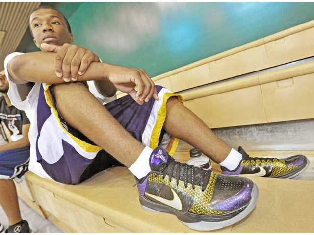 Jermaine Fields, 18, shows off a new pair of shoes in the gym at the Castaic Sports Complex recently.