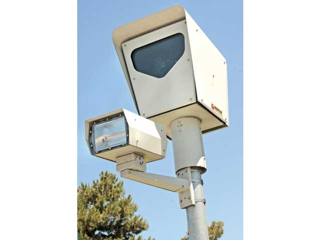 A red-light camera keeps watch on Magic Mountain and McBean parkways.