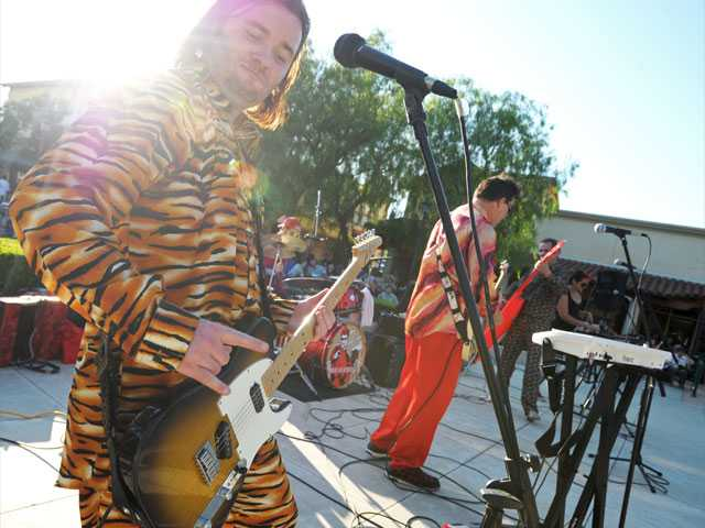 Guitarist Alex Akimov performs with Igor & Red Elvises at the Valencia Marketplace amphitheater recently.