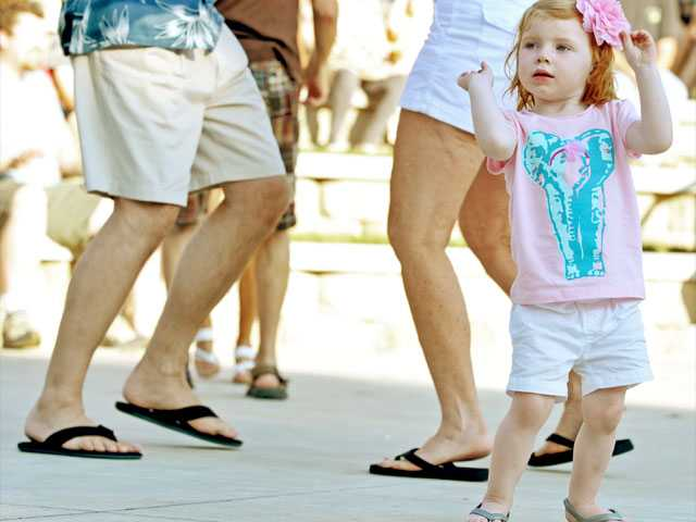 Harper Daly, 2, takes to the dance floor.