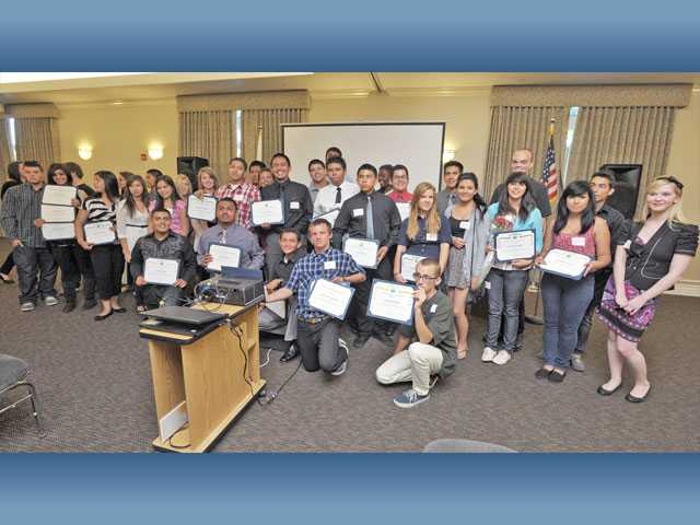 Participants in the city of Santa Clarita's Youth Employment Services program pose with their certificates for completion following a recognition ceremony at the Santa Clarita Activities Center in Canyon Country on Monday.