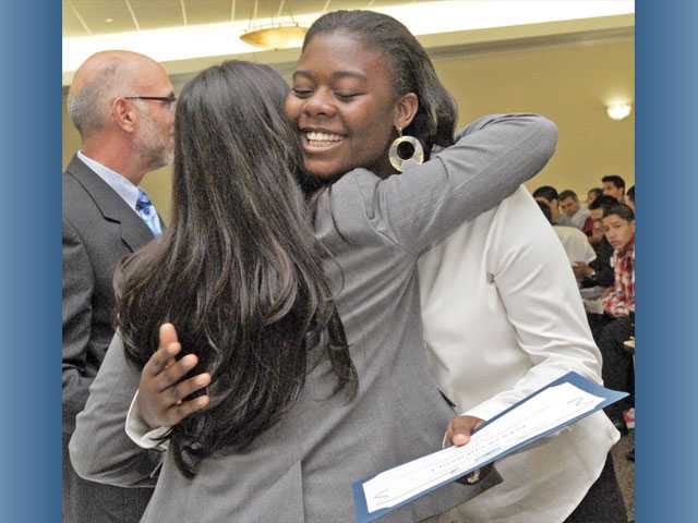 Community services supervisor Cynthia Llerenas congratulates Alexya Chenault, 15, on completing the Youth Employment Services summer program during a recognition ceremony at the Santa Clarita Activities Center in Canyon Country on Monday. Chenault spent the summer working at the Santa Clarita Community Center.