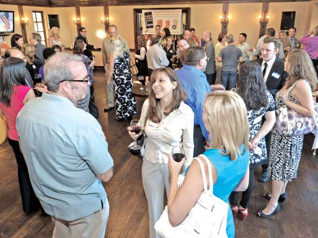 Attendees enjoy refreshments at the official launch reception of the edRover smartphone application at The Paseo Club in Valencia on Wednesday. The app, created by founder and CEO Tania Mulry, supports local businesses and education.