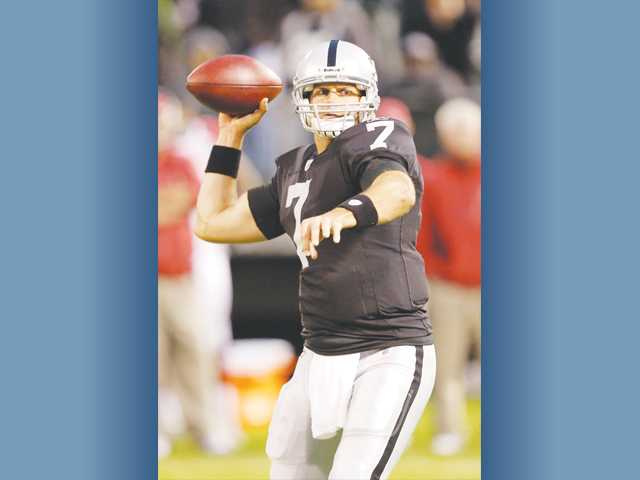 Oakland Raiders quarterback and former Hart High player Kyle Boller delivers against the Arizona Cardinals on Thursday in a preseason game in Oakland. He is listed as the team's No. 2 quarterback.