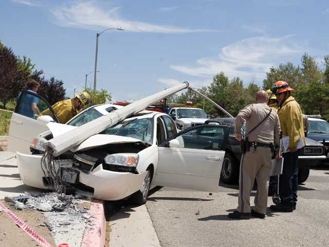 A minor two-car collision on Plum Canyon Road, near Golden Valley Road, in Saugus on Friday sent one car into a light standard that toppled onto it.